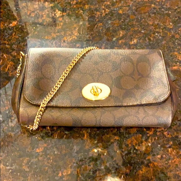 COACH Brown-black monogram clutch